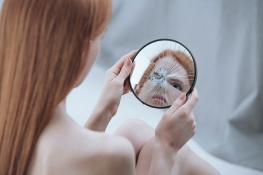 Distorted reflection of a woman